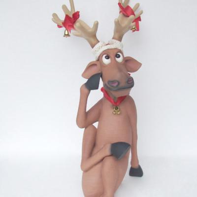kat1_funny-reindeer-sitting-crosslegs